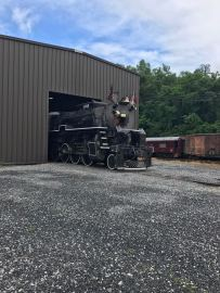 Moving the locomotive outside to be washed.