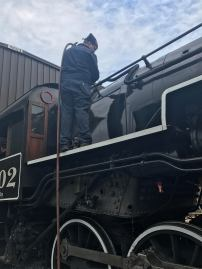 Marshal washing out the top of the crown sheet in the firebox.